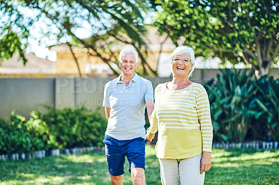 Buy stock photo Shot of a happy senior couple having fun in their backyard at home