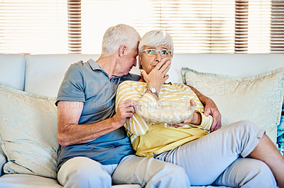 Buy stock photo Shot of a senior couple watching tv together on the sofa at home