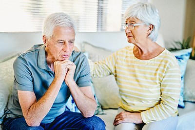 Buy stock photo Shot of a senior woman trying to console her husband who is upset at home