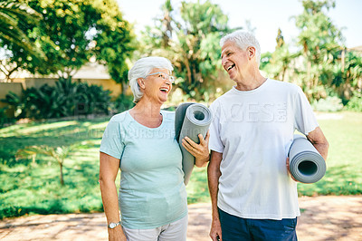 Buy stock photo Shot of a senior couple holding exercise mats while standing outdoors