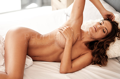 Buy stock photo Cropped shot of a gorgeous young woman lying naked with her eyes closed in her bedroom at home