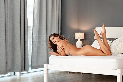 Buy stock photo Full length shot of a gorgeous young woman lying naked on her bed at home