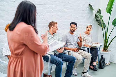 Buy stock photo Cropped shot of a diverse group of businesspeople sitting together while waiting for their interviewer in the office
