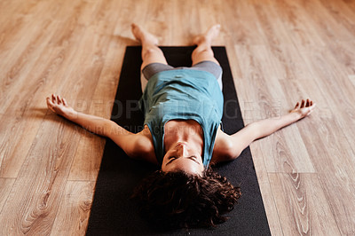 Buy stock photo Shot of a group of young woman resting after her yoga session