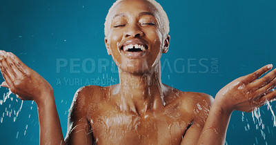 Buy stock photo Cropped shot of a beautiful young woman splashing water over her face