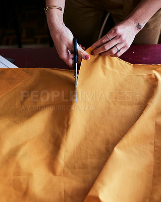 Buy stock photo Cropped shot of an unrecognizable fashion designer cutting fabric