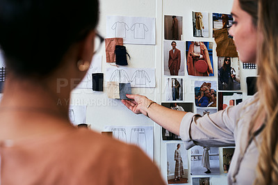 Buy stock photo Cropped shot of two fashion designers discussing ideas