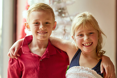Buy stock photo Portrait of two adorable young siblings posing together at home on Christmas day