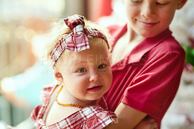 Buy stock photo Portrait of an adorable baby girl playing with her older brother at home
