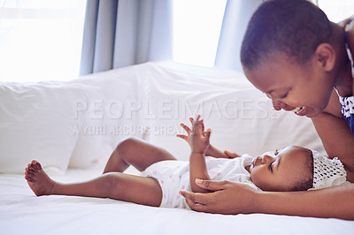 Buy stock photo Shot of a mother bonding with her baby daughter at home