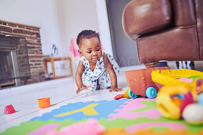 Buy stock photo Shot of an adorable baby girl crawling on the floor at home