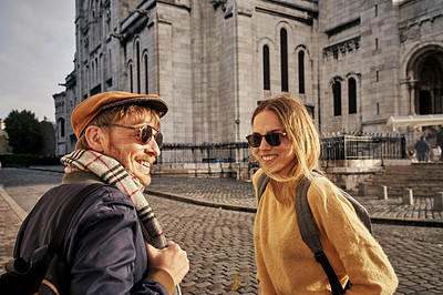 Buy stock photo Cropped shot of a happy young couple enjoying a day of sightseeing together in Paris