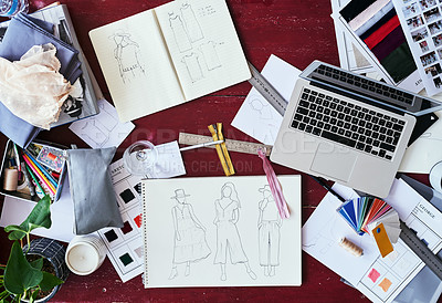 Buy stock photo High angle shot of a fashion designer's work desk