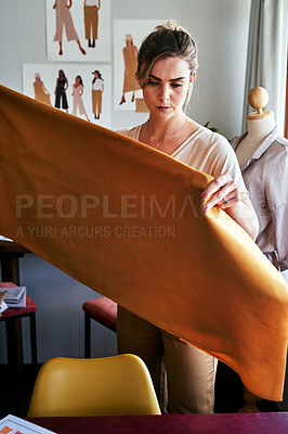 Buy stock photo Cropped shot of a designer working with fabric in her workshop