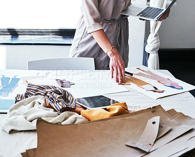 Buy stock photo Cropped shot of a fashion designer working on new designs at her desk
