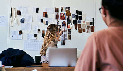 Buy stock photo Cropped shot of two fashion designers working together in a workshop