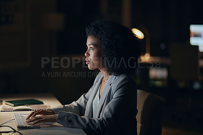 Buy stock photo Cropped shot of an attractive young businesswoman working on a computer during a late night at the office