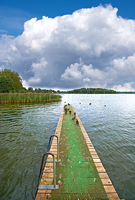 Buy stock photo A landscape pier and lake