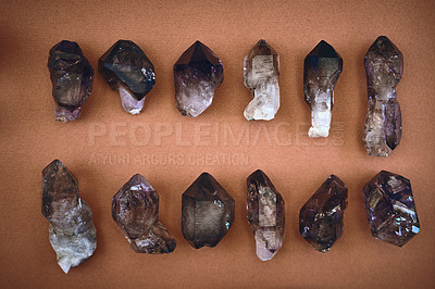 Buy stock photo High angle shot of a table filled with different types of crystals inside during the day