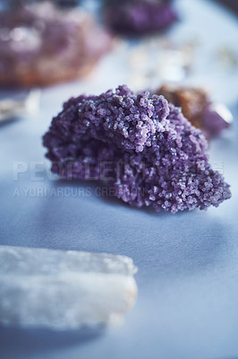 Buy stock photo Closeup of a beautiful crystal placed on a table with other different types of crystals during the day