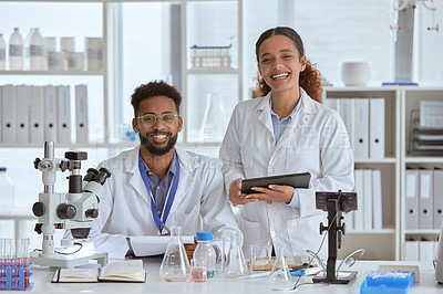 Buy stock photo Portrait of two young scientists working together in a lab