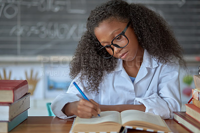 Buy stock photo Shot of a young girl doing school work in a mathematics class