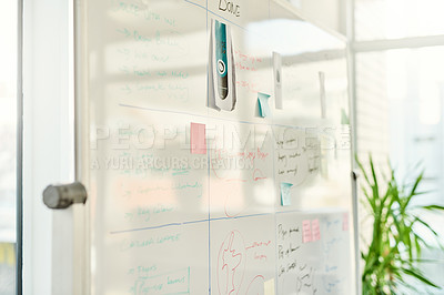 Buy stock photo Cropped shot of written plans on a white board in an empty office during the day