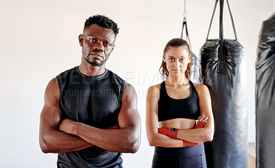 Buy stock photo Cropped portrait of a handsome young fitness coach standing with his trainee in a gym