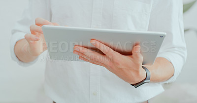 Buy stock photo Cropped shot of a businessman using a digital tablet in a modern office