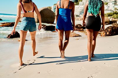 Buy stock photo Cropped shot of three unrecognizable female friends walking on the beach