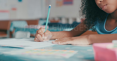 Buy stock photo Cropped shot of a young girl doing schoolwork in a classroom