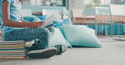 Buy stock photo Cropped shot of a young girl reading a book at school