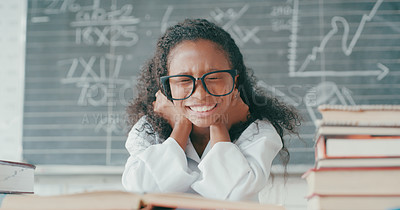 Buy stock photo Shot of a young girl looking frustrated while doing school work in a mathematics class