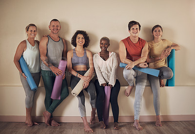 Buy stock photo Full length portrait of a diverse group of yogis sitting together and bonding after an indoor yoga session
