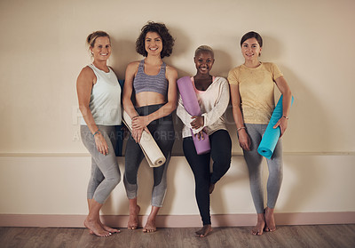 Buy stock photo Full length portrait of a young group of woman sitting together and bonding during an indoor yoga session