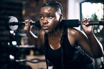 Buy stock photo Full length shot of an attractive young female athlete lifting weights in the gym