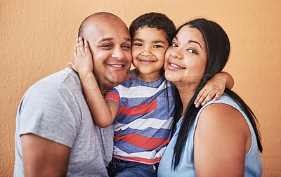 Buy stock photo Cropped shot of a cheerful young couple holding their son while smiling at the camera at home during the day