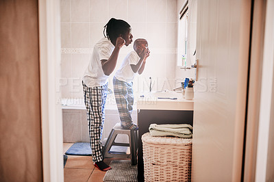 Buy stock photo Cropped shot of a young man and his son being playful in the bathroom at home