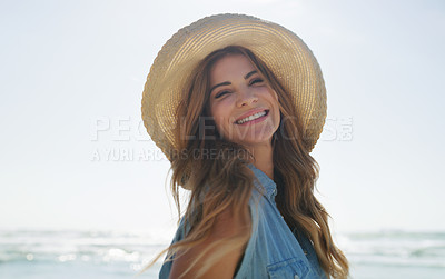 Buy stock photo Cropped portrait of an attractive young woman enjoying the beach on a summer's day