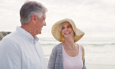 Buy stock photo Cropped shot of an affectionate senior couple enjoying the beach on a summer's day