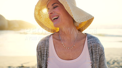Buy stock photo Cropped shot of an attractive senior woman enjoying the beach at sunset