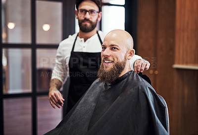 Buy stock photo Cropped shot of a handsome young man looking happy after getting a haircut at a barbershop