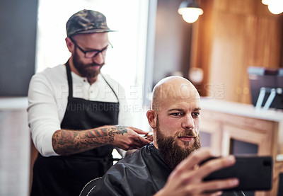 Buy stock photo Cropped shot of a handsome young man getting a haircut at a barbershop