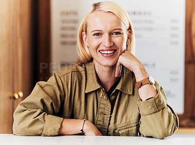 Buy stock photo Portrait of an attractive young hairdresser working at the reception area of her salon