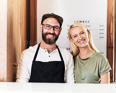Buy stock photo Portrait of a happy young barber and hairdresser posing together inside their salon