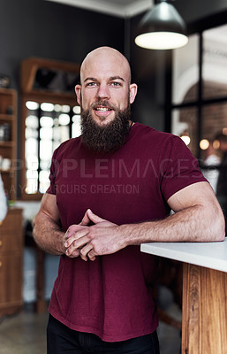 Buy stock photo Portrait of a handsome young barber posing inside his barbershop