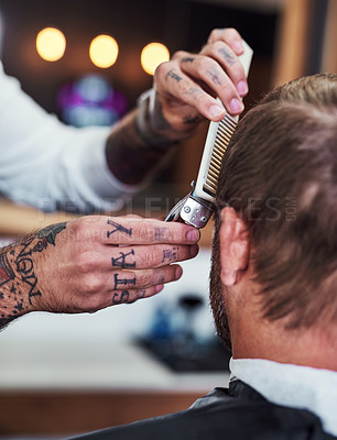 Buy stock photo Cropped shot of an unrecognizable man getting a haircut at a barbershop