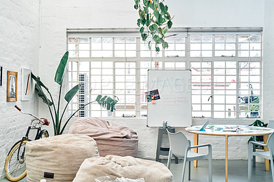 Buy stock photo Cropped shot of an empty office space before a meeting during the day