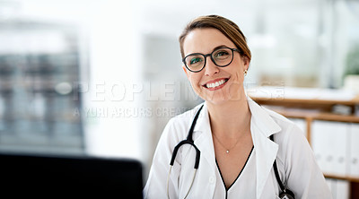 Buy stock photo Portrait of an attractive young female doctor working in her office at the hospital