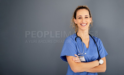 Buy stock photo Portrait of an attractive young nurse posing against a grey background